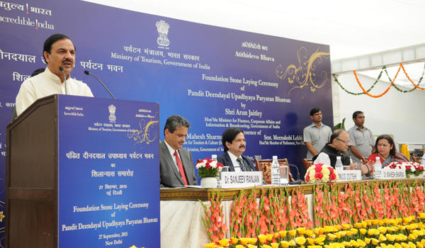 "The Minister of State for Culture (Independent Charge), Tourism (Independent Charge) and Civil Aviation, Dr. Mahesh Sharma addressing at the foundation stone laying ceremony of the new building of Tourism Ministry ""Paryatan Bhawan"", on the occasion of the World Tourism Day, in New Delhi on September 26, 2015. 	 The Union Minister for Finance, Corporate Affairs and Information & Broadcasting, Shri Arun Jaitley, the Secretary of Tourism, Shri Vinod Zutshi and other dignitaries are also seen."